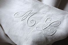 Stunning antique French linen sheet ~ ML monogram ~ ideal used for Swedish, French Country , Beach house, Cottage interior ~ beautiful homespun hand woven fabric from France . Ideal for upholstery, bed cover, shower curtain , pillow fabric, etc  ~ www.textiletrunk.com