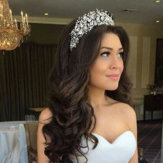 Suzanne working her regal bridal look! The custom designed bridal tiara headpiece she chose from our boutique is so perfect with the rest of her wedding day look!