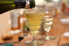 Pineapple-Ginger Sparkling Wine Cocktail - 1-inch (3cm) cube fresh pineapple - 1/4-inch (1cm) slice fresh ginger, unpeeled - 1 teaspoon sugar  1/2 ounce fresh lime juice - 1 1/4 ounce rye whiskey - Champagne or sparkling wine      1. In a cocktail shaker, muddle the pineapple with the ginger and sugar.    2. Add the lime juice and whiskey, then add some ice to the shaker and shake vigorously for about 15 seconds. Strain the mixture into a glass then top the glass