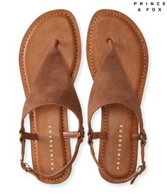 """Make this Prince & Fox Triangle O-Ring T-Strap Sandal the crown jewel of your footwear collection! It's designed with a faux suede triangle t-strap, while the buckled closure promises a super-secure fit.<br><br>Height: 3""""<br>Style: 2920. Imported.<br><br>Man-made materials."""