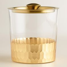 Conveniently serve your guests from our glass ice bucket complete with a lid and tongs, featuring luxe faceted gold metal detail along the bottom.