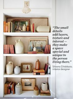 Designer Silvana D'addazioknows that it's the unexpected touches that make a space memorable. In her own home, a seashell light fixture riffs on the nature-themed artwork on a bookshelf.She lined the back of the shelves with a subtle cotton-wool fabric trimmed with a grosgrain ribbon, which plays nicely with her antique books.