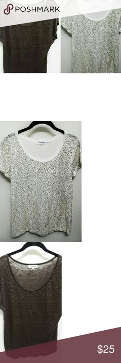 2 Calvin Klein Teeshirts * gold sequins sz Med 1. White cotton Tee shirt with tiny gold sequins.  Sz Medium. Calvin Klein  2. Brown tissue weight tee shirt with hold flecks in the fabric. This is a size small but listing it with a medium top because it's oversized and fits medium well. Also Calvin Klein. Calvin Klein Tops Tees - Short Sleeve