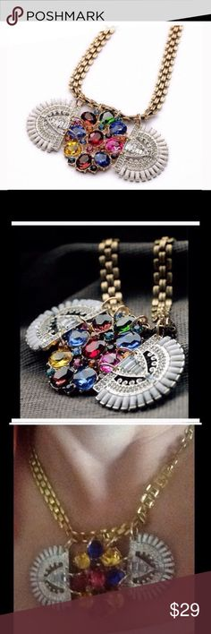 Crystal flower pendant gold chain exquisite. Beautiful floral colored stones surrounded by clear crystals finished with the flow of the stones a gold chain.  Sets perfectly on the neckline. Jewelry Necklaces