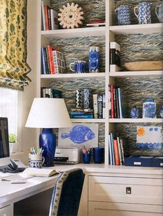 Wallpapering Bookshelves adds a whole new dimension not to mention color to a room #blueandwhite #decordetails #stylebeat