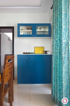 Got a lot of crockery and dinnerware? Invest in a modular unit in your dining area. Make it bright, and store all your essentials with ease. We are loving this blue! Interior Work, Best Interior, Home Interior Design, Dining Rooms, Dining Area, Design Your Home, House Design, L Shaped Kitchen, Dinnerware