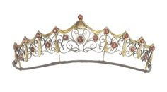 A silver gilt and garnet tiara, by Child & Child, circa 1900  Of openwork scrolling design, decorated throughout with circular-cut garnets, maker's mark, width 14.2cm.