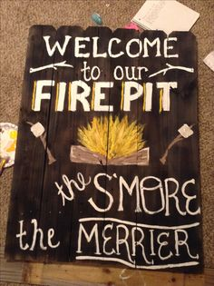 Welcome to our fire pit the s'more the merrier.   Firepit sign from repurposed fencing