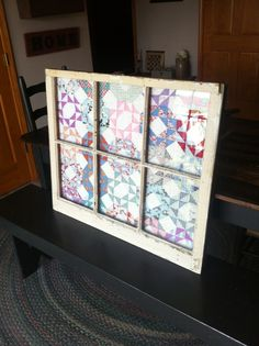 Primitive window with quilt.