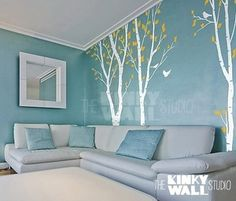West wall in living room. Paint wall blue- add trees