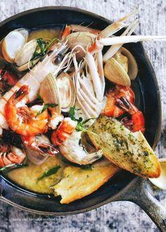 Garlig, tarragon and seafood hotpot