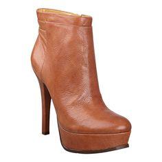 "Almond toe platform bootie.  Side full zipper.  Leather upper.  Covered 5"" heel and 1 1/4"" platform."