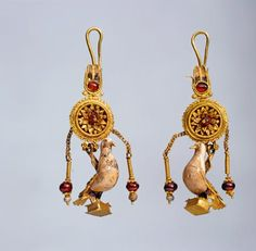Earrings with pendants in the form of a dove. Greek, Alexandria (?). 2nd century BC. Gold, hessonite, glass, h 6.3/6.5 cm. © State Hermitage Museum, St Petersburg.