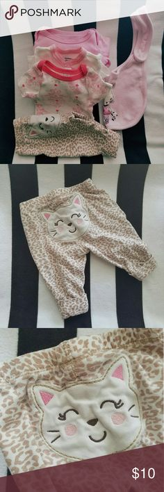 Baby Bundle! All in excellent condition  Size Newborn   3 tops  One pair of cat pants One bib Koala Kids One Pieces Bodysuits
