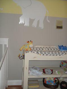 Repainted book shelf for changer.    Grandma's nursery