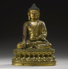 GILT-BRONZE FIGURE OF SHAKYAMUNI BUDDHA YONGLE MARK AND PERIOD