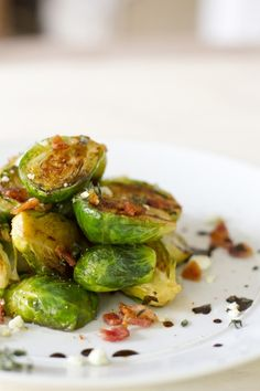 CARAMELIZED BRUSSEL SPROUTS W/ BLUE CHEESE & BACON   ½ lb. Brussel sprouts  2 strips of bacon  ½ cup chicken stock  ¼ cup blue cheese crumbles  ¼ cup balsamic vinegar  2 sprigs of thyme  Salt and pepper to taste