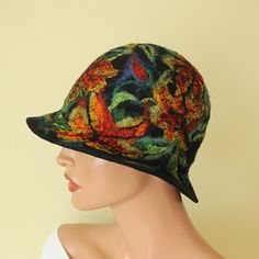 One of a kind, fairytale hat, joyous and cheerful.    It is hand felted, made using only natural materials: wool, silk hand painting and soap and