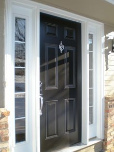 Black and white front door with sidelites