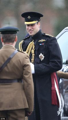 William presented medals to military medics who helped in the fight against Ebola. Personn...
