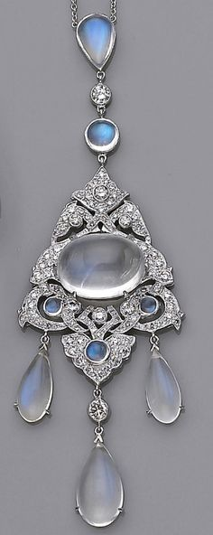 A moonstone and diamond necklace centering a oval-shaped cabochon moonstone, accented by round brilliant and single-cut diamonds, completed by pear-shaped cabochon moonstone drops, and collet-set moonstone chain; estimated total diamond weight: 2.00 carats; mounted in eighteen karat white gold; length: 16in.