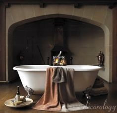 clawfoot bathtub with a fireplace