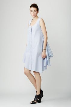 Made of a blue and white striped cotton, this lightweight shirtdress is sleeveless, with a button-down style. Layer it with jeans or wear it alone for easy-breezy style.