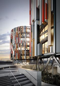 Contemporary office architecture featuring multi coloured, finned cladding system. Cylindrical building.   Architecture and CGI by Pikcells.