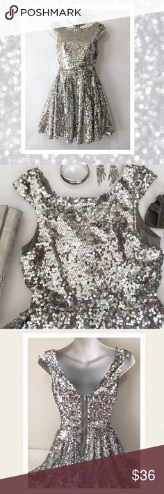 """Sparkle and shine! Sequined skater dress. This poly knit dress is fully encrusted with thousands of silver sequins that will shimmer and sparkle under the lights of your holiday party! It swings around when you dance, picking up every color in the room with it's cool reflecting quality. Perfect for twirling on ice skates under a bright winter moon. Fully lined, zips in back. Perfect condition. Worn once. Appx measurements: bust 29"""" un stretched waist 25"""" un stretched length 31"""" hip area 44""""…"""