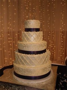 This was my wedding cake from Betty Janes Bakeshoppe in San Antonio!! I loved it and it was yummy too! Elegant Pearl  : This cake alternated designs of delicate beaded lattice and intricate scroll work.