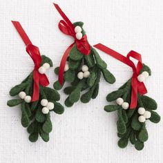 Felt Mistletoe Seasonal use white pom poms and felt and a red ribbon