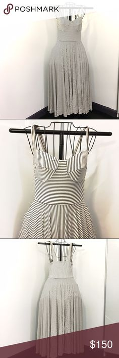 Nadia Tarr RARE bustier top pinstripe Maxi Dress I don't believe this one ever went into production, might be one of a kind. She did this design in navy and pink, but this might be the only one in white w/ black pinstripes. It's awesome and I love it and am hesitant to sell!  Bustier top, full maxi skirt. Jersey stretch fabric. Size L. The model in the 4th pic is wearing the navy version.  Worn once! Nadia Tarr Dresses Maxi