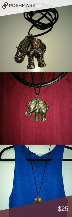 Elephant Pendant Necklace NWOT. Elephant good luck charm, pretty brass color with contrasting detail and subtle colored rhinestones  on top, for just enough shine to play up a solid colored top.   Adjustable length suede necklace with sliding adjuster. High quality charm. Jewelry Necklaces