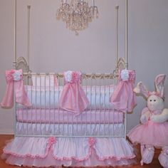 Cupcake Crib Bedding by Little Bunny Blue.  This adorable crib set is as sweet as a cupcake. The white and bright pink washable silk fabrics  are crafted to a tee with  gorgeous handmade fabric roses  that adorn every bow.  The scalloped dust ruffle with addition roses, ruffles and tulle is perfect for everyones little Princess. We are so fortunate to  have the most gifted seamstresses in all of the land bringing magic to our designs. This crib bedding is nothing less than magical!
