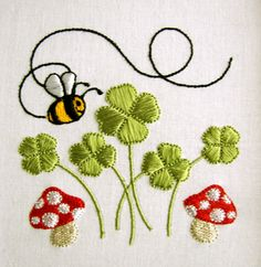 Mushrooms, clovers and a bee :-) looks too perfect like machine embroidery...