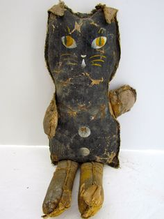 http://artantiquesmichigan.com/19th-century-oil-cloth-cat-doll-so-delightful/