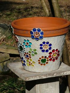 Mosaic Flower Pot made from stained glass and glass beads.  This is exactky what im working on for my moms mothers day plants I got her.