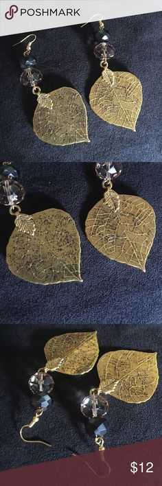 Gold leaf dangle earrings 3 inch long gold leaf dangle earrings. They are gold tone not real gold. These are handmade with care. Jewelry Earrings