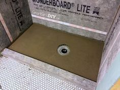 how to build a shower floor otu of dry pack mortar almost finished here