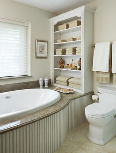 Love the bookcase look of the storage at the end of the tub. Also like the shape of the tub surround.