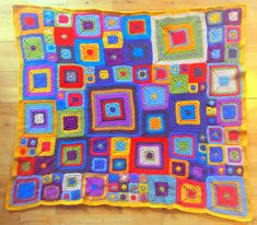 Multicolored #Crochet granny squares are perfect when put together like this.