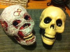 Dollar store skull + plastic wrap + paint = Halloween on the cheap!!!
