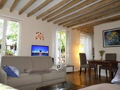 It's a lovely apartment with a beautiful terrace full of greens ,located on the 5th floor of a characteristic 18s century building in the heart of the Marais.Inside the apartment are exposed timber roof beams and ...