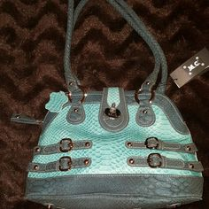 AQUA MADI CLAIRE LEATHER HANDBAG NWT Outside Zipper Pocket, large outer zippered pocket. Zipper closure with magnetic closure as well. Outer pocket with IPhone pouch, two inner slots for phone and sunglasses. Belted design. Beautiful well made Braided Handles. Footed Bottom for protection. Genuine Leather satchel. Awesome summer bag. I paid the full price on flex pay, but I literally have Hundreds of Bags and I'm trying to narrow them down.  Madi Claire Bags Satchels