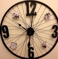 "DIY wall clock from bike wheels. I would probably use Roman numerals to make it look more ""vintage""."