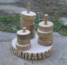 Toddler Branch Stacker- This set is handmade of ash branches and is untreated. There are 15 stacking pieces to go on the poles - helpful for learning counting and more/less as well as developing fine motor skills. The base measures approximatey 4 - 5 inches in diameter and each stacking smaller piece is between one to two inches in diameter.