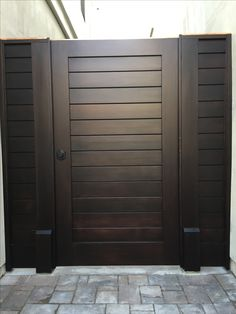 Custom Contemporary Wood Gate with Matching Panels by Garden Passages