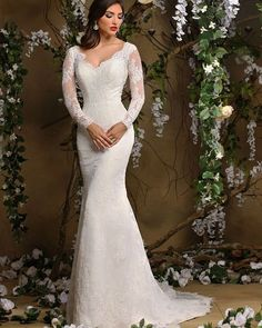 How do you like this couture gown from our Bella Mia collection? It features beautiful lace appliques check it out!