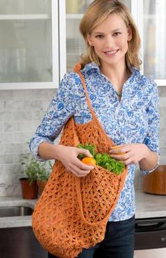 Lacy Crochet Market Bag: Keep this roomy bag handy for shopping or when travelling. Crochet it in a bright color as shown, or any color you wish. This is a great gift and a simple way to encourage ecology. As always - pattern is FREE!