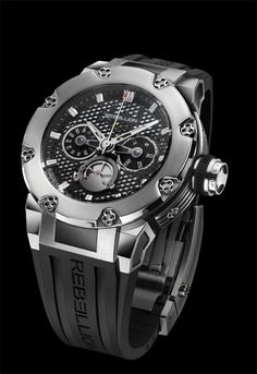 Predator Chrono Mono-Pusher with steel case. Many characteristics of the Predator, both technical and aesthetic, are inspired directly from racing cars - like the brake disks and the pedals - and are found throughout the watch. Despite the watch's avant-gardist nature, the Predator is crafted with respect to horologic tradition. For more information, please visit: http://www.rebellion-timepieces.com/collection-predator-chrono-mono-pusher.php#1